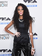 Winnie Harlow attended the MTV MVA kickoff concert wearing a fitted black top with white trim.