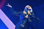 Bebe Rexha performed at the MTV VMA kickoff concert looking edgy in a cropped leather jacket.