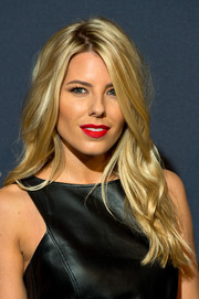 Mollie King punched up her beauty look with a swipe of matte red lipstick.