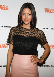Julia Jones wore her silky hair in a straight bob at the 'Machine Gun Preacher' premiere. She just created a center part and applied a product like Oscar Blandi Olio Di Jasmine Shine Spray to dry hair.