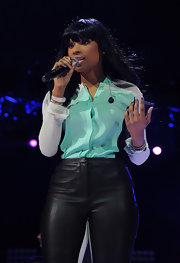 Jennifer Hudson softened up her stage look with this sea foam and gray button down.