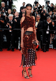 Liya Kebede rocked a Proenza Schouler cutout dress at the 'Mad Max: Fury Road' premiere, featuring a heavily sequined copper top and a sheer black skirt.