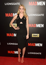 For her bag, Lindsay Ellingson picked a simple black envelope clutch.