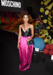 Alexandra Shipp was a rocker princess in a black and magenta leather-bodice gown by Moschino during the label's fashion show.