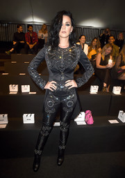 Katy Perry couldn't be missed in her bejeweled black Moschino jumpsuit during the label's fashion show.