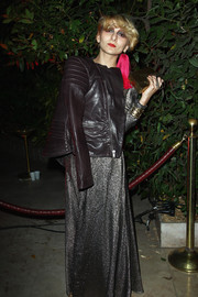 Catherine Baba layered a brown leather jacket over a glittery evening dress for an edgy-glam finish at the 'Mademoiselle C' cocktail party.