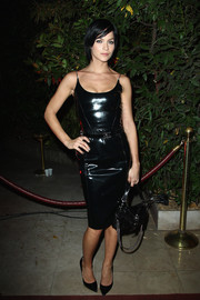 Leigh Lezark sported an edgy-sexy vibe in this black leather dress by Versace during the 'Mademoiselle C' cocktail party.