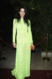 Angie Harmon swathed herself in a long-sleeve yellow lace evening dress by Valentino for the 'Mademoiselle C' cocktail party.