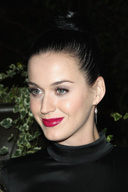 Katy Perry swept her hair up in a sophisticated top-knot for the 'Mademoiselle C' cocktail party.