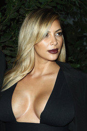 Kim Kardashian looked oh-so-sexy with this side-parted 'do and low-cut dress combo at the 'Mademoiselle C' cocktail party.