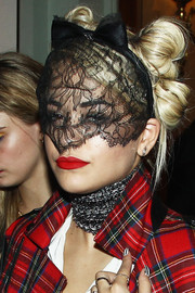 Rita Ora looked bizarre with her hair knots accessorized with a lace-embellished cat-ear headband during the 'Mademoiselle C' cocktail party.