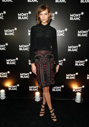 Karlie Kloss looked flawlessly styled in a patterned pencil skirt and a black button-down during the Montblanc Madison Avenue opening.