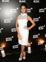 Olivia Munn teamed two-tone ankle-strap sandals by Armani with a white sheer-panel dress for a stylish finish at the Montblanc Madison Avenue opening.