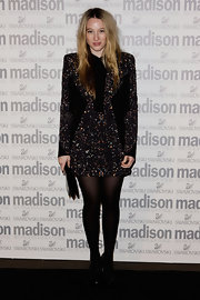 Sophie wore a sparkling, long sleeve dress with black panels and padded shoulders.