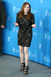 Strappy black heels by Aquazzura put a modern twist to Julianne Moore's look.