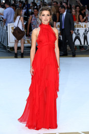 Amber Heard made a very charming choice with this red ruffle halter gown by Emilio Pucci for the 'Magic Mike XXL' European premiere.