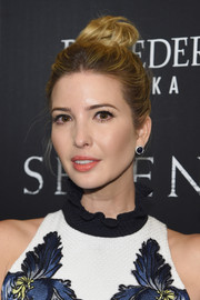 Ivanka Trump pulled her locks up into a messy-chic top knot for the screening of 'Serena.'