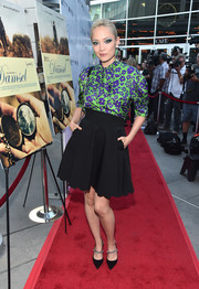 Pom Klementieff completed her cute outfit with a scalloped mini skirt, also by Miu Miu.