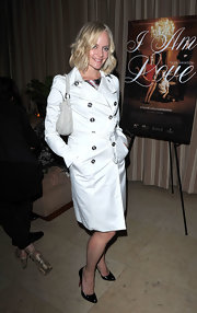 Marley Shelton looked classic in black patent pumps and a timeless knee length trench.
