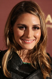 Olivia Palermo wore casual, messy-chic waves to the Magnum 25th anniversary celebration.