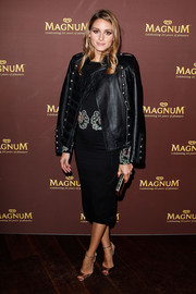 Olivia Palermo looked ready for fall in a Boda Skins military leather jacket layered over an embroidered LBD during the Magnum 25th anniversary celebration.