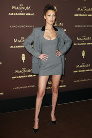 Bella Hadid flaunted her legs in a gray mini dress by Alexander Wang at the Magnum VIP party during Cannes.