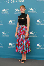 Maya Hawke added an ultra-feminine touch with a pleated floral skirt.