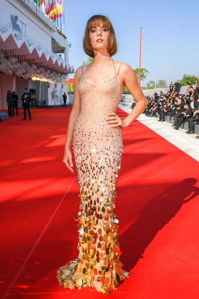 Maya Hawke channeled her inner mermaid in a body-con beige Atelier Versace gown with gold paillette embellishments at the Venice Film Festival screening of 'Mainstream.'