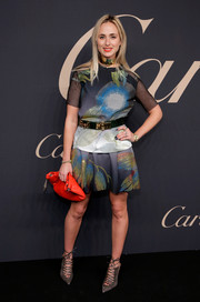 Elisabeth von Thurn und Taxis donned an abstract-print blouse with sheer sleeves for the 100th anniversary of La Panthere de Cartier.
