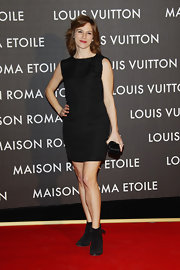 Stefania Montorsi paired her black frock with black suede ankle boots.