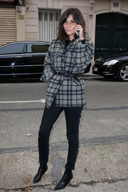 Emmanuelle Alt kept it low-key in a gray plaid wool jacket and black skinny jeans during the Maison Martin Margiela fashion show.