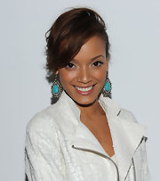 Selita Ebanks offset her white jacket with diamond and turqouise earrings.