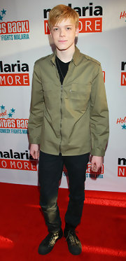 Cameron Monaghan wore a utilitarian green zip-up jacket to the 'Hollywood Bites Back!' event.