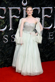 Elle Fanning looked sweet and glam in a pale mint-green gown with a mesh overlay and ruffled sleeves at the European premiere of 'Maleficent: Mistress of Evil.'