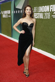 Olga Kurylenko looked sizzling-hot in a strapless, high-slit black dress by Ulyana Sergeenko at the UK premiere of 'The Man Who Killed Don Quixote.'