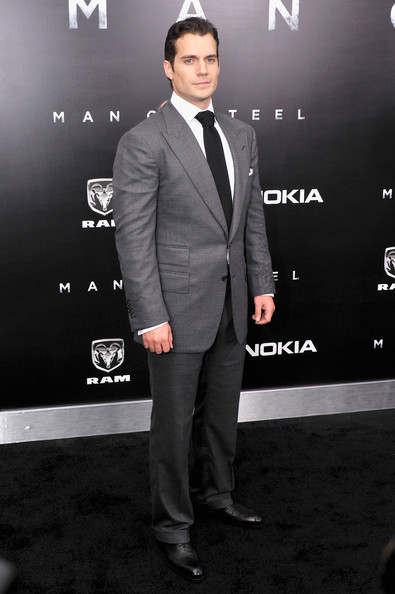 Henry Cavill showed off his stellar style with this charcoal, peak-lapel suit.
