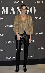 Raquel wears a cropped fur coat over black leggings with a Chanel bag at the Mango Collection Presentation.