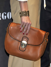 Olivia Palermo attended the launch of Mango's new collection sporting a classic leather clutch in a tan hue that's perfect for the fall season.