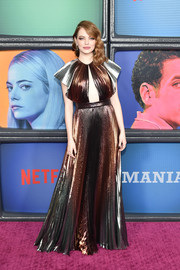 Emma Stone looked mesmerizing in a metallic cutout gown by Givenchy at the 'Maniac' season 1 premiere.