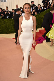 Catt Sadler made jaws drop with this curve-flaunting white cutout gown by Hamel at the Met Gala.