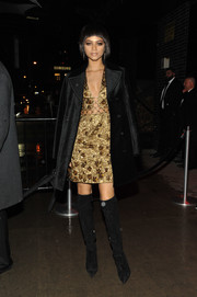 Zendaya Coleman pulled her outfit together with black knee-high boots by Giuseppe Zanotti.