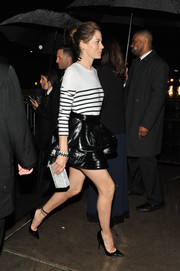 Michelle Monaghan dolled up her casual top with a flirty leather mini skirt.