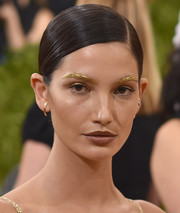 Lily Aldridge opted for a slicked-down side-parted bun when she attended the Met Gala.