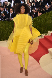Solange Knowles showed off her unique style with this origami-inspired yellow dress by David LaPort at the Met Gala.