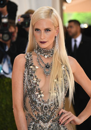 Poppy Delevingne went for a sexy-edgy beauty look with dark red lipstick.