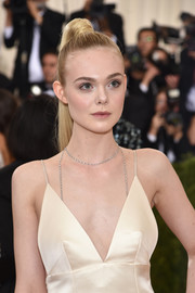 Elle Fanning opted for an elegant high ponytail when she attended the Met Gala.
