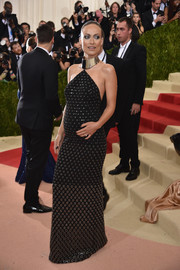 Olivia Wilde went rocker-chic in a grommeted halter gown by Michael Kors for her Met Gala look.