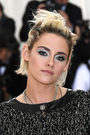 Kristen Stewart caught eyes with her futuristic beauty look.