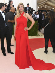 Ivanka Trump went for a bit of '70s zing in a flared red Ralph Lauren  halter jumpsuit with a long train for her Met Gala look.
