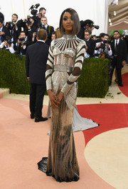Jourdan Dunn exuded futuristic glamour at the Met Gala in a beaded silver Balmain gown with geometric sheer panels.